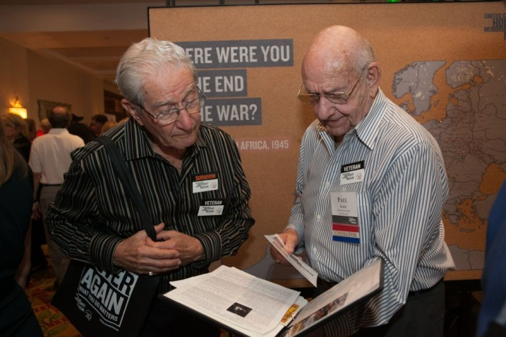 Veterans at the U.S. Holocaust Memorial Museum's travelling exhibit.