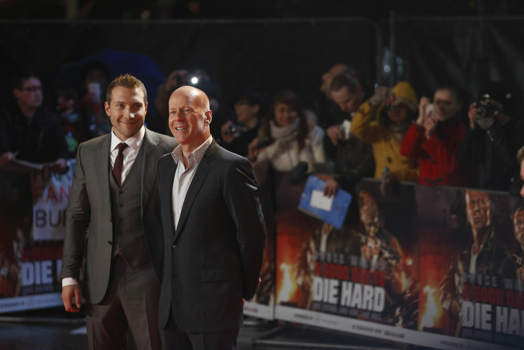 Australian actor Jai Courtney (L) and US actor Bruce Willis (R) pose for photographers while arriving for the UK premiere of 'A Good Day To Die Hard', the fifth film in the Die Hard franchise, in central London on February 7, 2013.