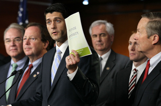Flanked by other congressionial members, U.S. Rep. Paul Ryan (R-WI) (C), chairman of the House Budget Committee, holds up a copy of the 2012 Republican budget proposal during a news conference April 5, 2011 on Capitol Hill in Washington, DC.
