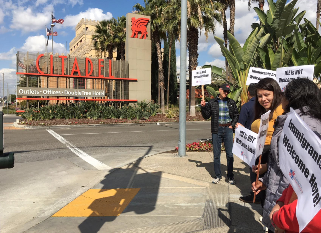 Immigrant advocates demonstrate outside the Citadel outlet mall in Commerce this week. Immigration agents visited a restaurant there to gather work documents as part of stepped-up audits of local businesses.