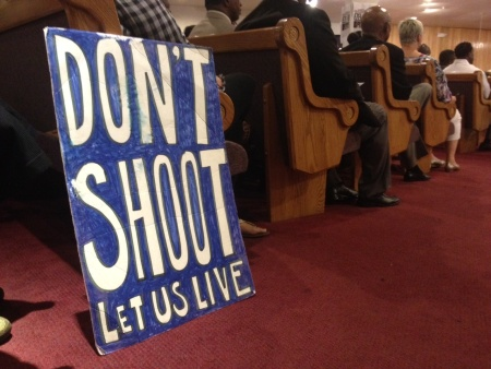 People sit in the pews at Paradise Baptist Church in South LA. LAPD Chief Charlie Beck addressed a community meeting about the fatal police shooting of Ezell Ford.