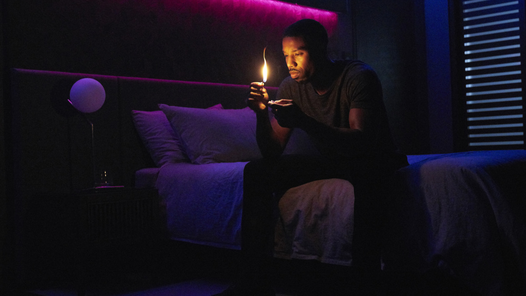 Erasing Himself From The Narrative: Fireman Guy Montag (Michael B. Jordan) contemplates conflagration in the HBO movie <em>Fahrenheit 451</em>.