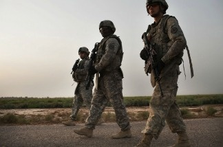 U.S. soldiers with the 3rd Armored Cavalry Regiment participate in a patrol on July 15, 2011 in Iskandariya, Babil Province, Iraq.