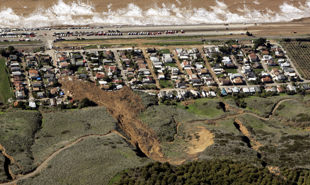 The scene of a large mudslide that on Monday, Jan. 10, 2005, resulted in the deaths of 10 people and the loss of more than a dozen homes, in the coastal community of La Conchita, Calif., is shown Tuesday, Jan. 11, 2005. The community suffered a similar mudslide, killing residents and destroying homes, in 1995. Despite the dangers of living in scenic splendor atop hills or on their slopes, many California homeowners are willing to live with the risks from natural disasters.