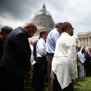 WASHINGTON, DC - JUNE 18: Rep. John Lewis (D-GA) (L) joins members of the US House of Representatives and members of the US Senate in a prayer circle in front of the US Capitol to honor those gunned down last night inside the historic Emanuel African Methodist Episcopal Church in Charleston South Carolina, June 18, 2015 in Washington, DC. Police have arrested Dylann Roof, 21, of Lexington, South Carolina in the shooting that killed 9 people. (Photo by Mark Wilson/Getty Images)