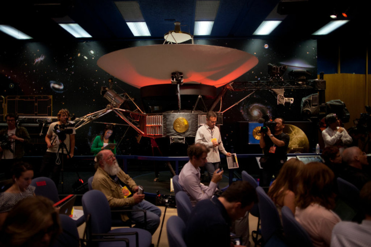 The project leadership team for the Curiosity mission to Mars prepares to take a bow before a press conference at the Jet Propulsion Laboratory in Pasadena late Sunday night.