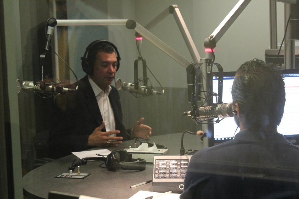 California Secretary of State Alex Padilla talks to A. Martinez.