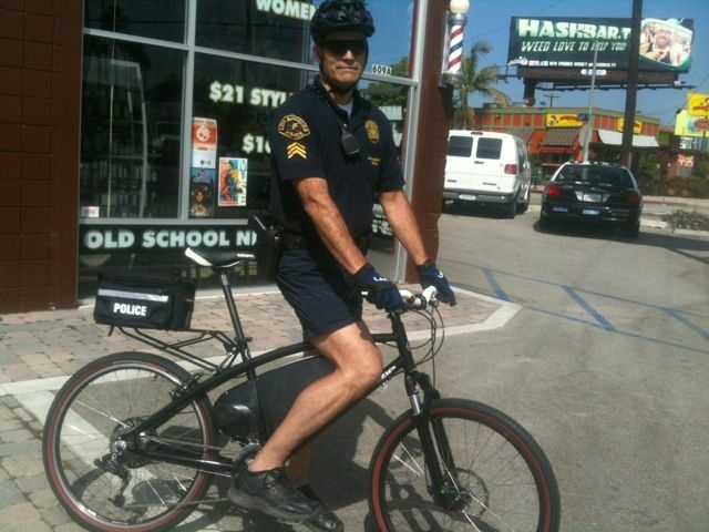 LAPD Sargent Matthew Bygum on the department's new electric hybrid bicycle.