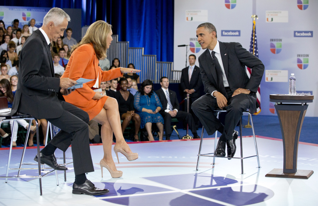 President Barack Obama participates in a town hall hosted by Univision and Univision news anchors Jorge Ramos, left and Maria Elena Salinas, center, at the University of Miami, Thursday, Sept. 20, 2012, in Coral Gables, Fla.