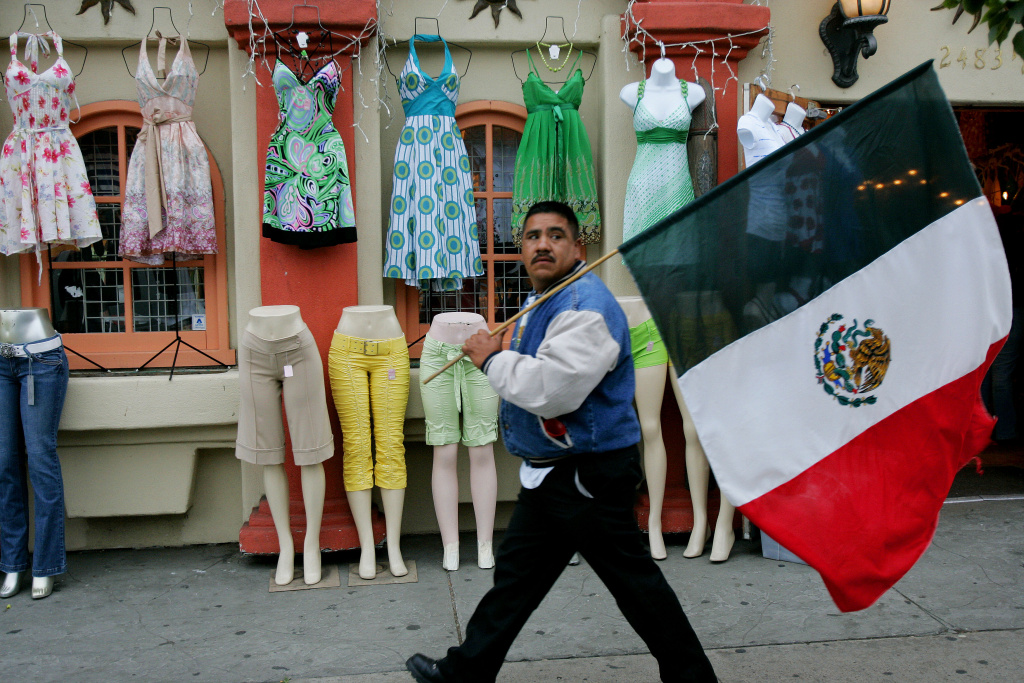 A demonstrator walks through the Barrio Logan area during an immigration march on May 1, 2007 at Chican Park in San Diego, California.
