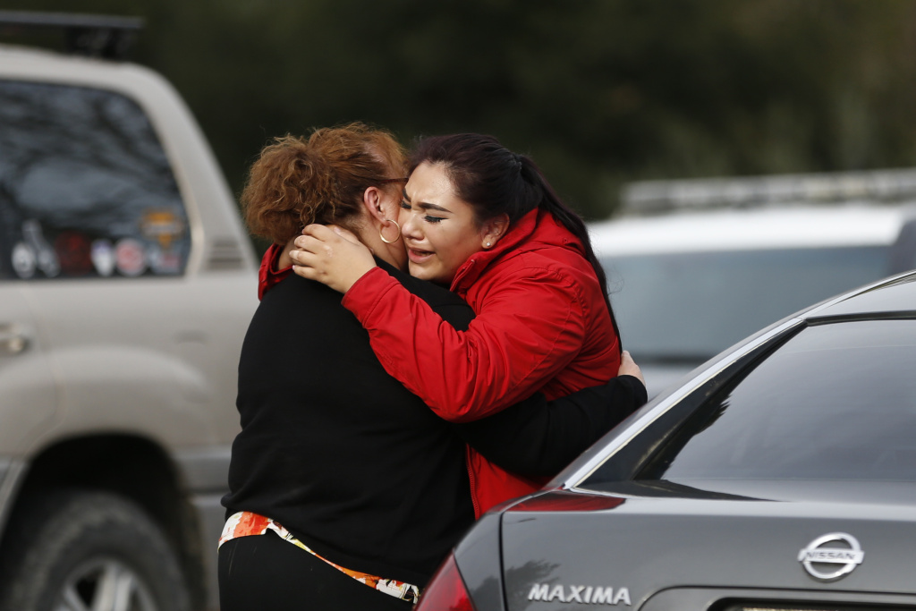Vanessa Flores (right) embraces another woman after she leaves the locked down Veterans Home of California during a hostage situation on March 9, 2018 in Yountville, California.
