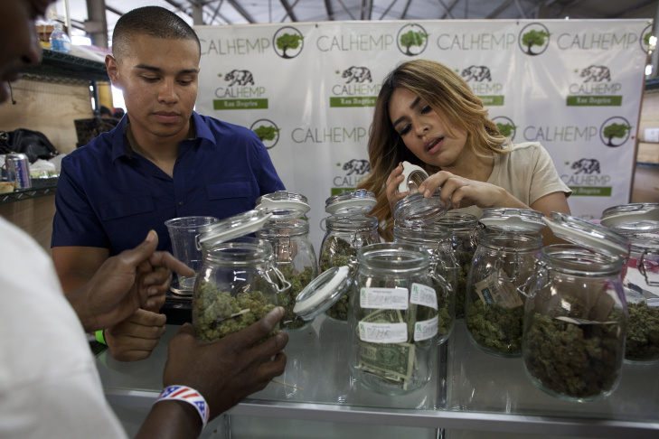 About a thousand people Friday wait in line outside the new California Heritage Market, a cannabis farmers' market in Boyle Heights.