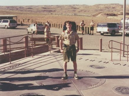Former Boy Scout Alan Eckert in 2000 standing on the Four Corners National Monument.