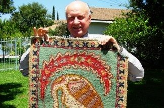 Charles Perry displays a rug given to him by the late Owsley Stanley.