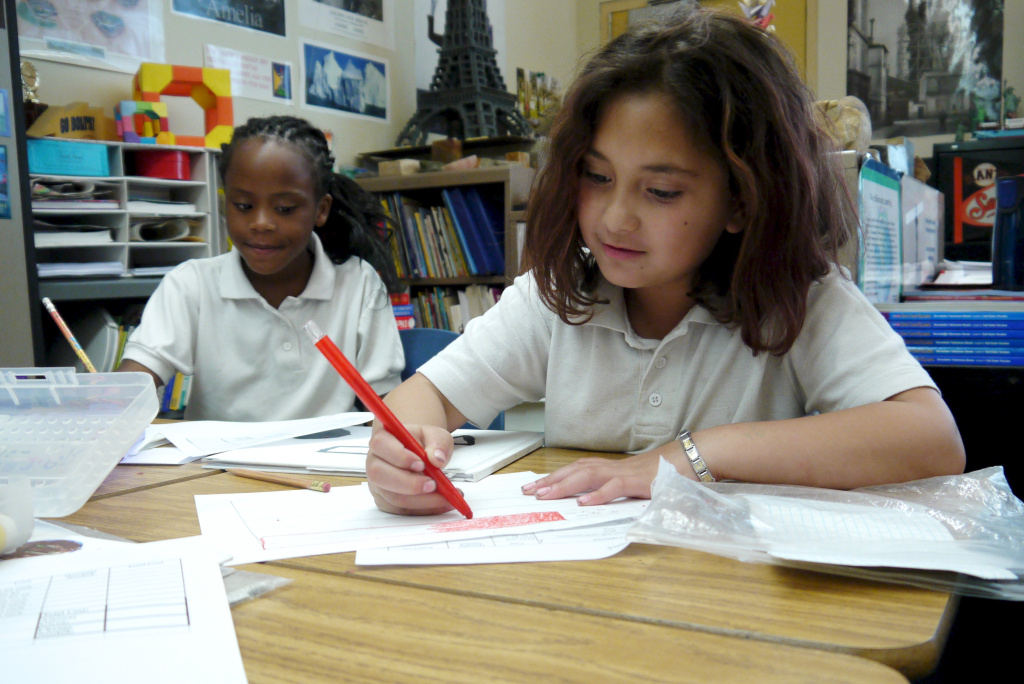 Kourtney (left) and Gina (right) work on sketching ideas for their sculptures in Ms. Grotts third grade class in Pasadena.