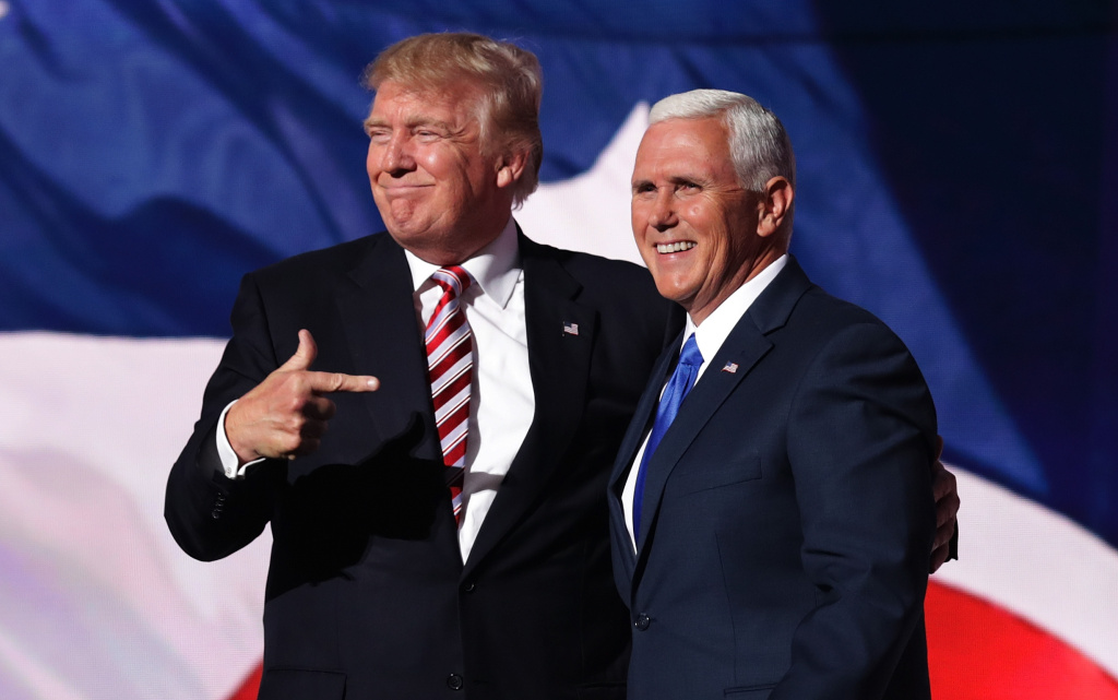 President Donald Trump stands with Vice President Mike Pence on the third day of the Republican National Convention on July 20, 2016.