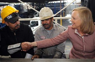 Meg Whitman, Republican nominee for governor, meets Latino employees of Ramcast Ornamental in Los Angeles, California on October 21, 2010.
