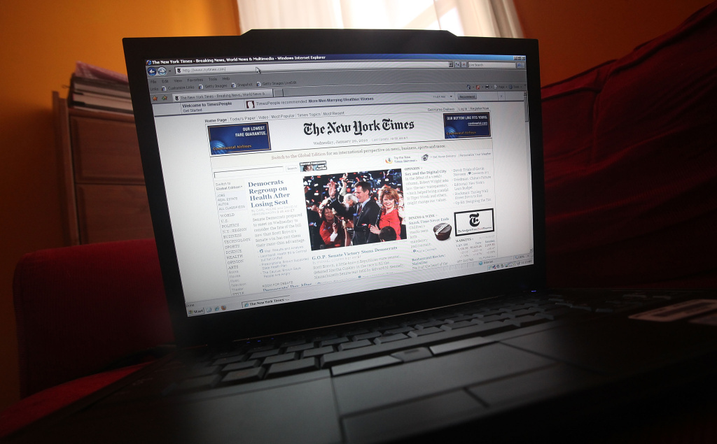 In this photo illustration the NYTimes.com Web site is displayed on a laptop.