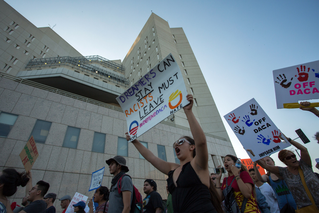 LOS ANGELES, CA - SEPTEMBER 05: Immigrants and supporters march past the Metropolitan Detention Center as undocumented people jailed inside tap on the windows in opposition to the President Trump order end to DACA on September 5, 2017 in Los Angeles, United States. The Obama-era Deferred Action for Childhood Arrivals program protects young immigrants who grew up in the U.S. after arriving with their undocumented parents from deportation to a foreign country. The executive order by the president removes protection for about 800,000 current 'dreamers', about 200,000 of whom live in Southern California. Congress has the option to replace the policy with legislation before DACA expires on March 5, 2018.  (Photo by David McNew/Getty Images)