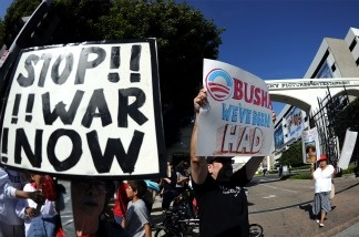 Demonstrators protest in front of Sony Pictures Studios on April 21, 2011, as President Barak Obama attends a major fundraiser for his 2012 billion-dollar presidential reelection campaign.