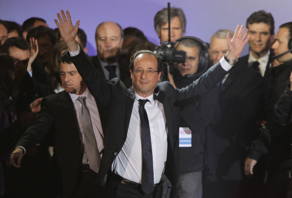 PARIS, FRANCE - MAY 06:  French President-Elect Francois Hollande greets thousands of gathered supporters at Place de la Bastille after victory in French Presidential Elections on May 6, 2012 in Paris, France. Socialist Francois Hollande has defeated incumbent president and UMP candidate Nicolas Sarkozy, with a projected 52% of the vote in the second and final round of the French Presidential elections.  (Photo by Sean Gallup/Getty Images)
