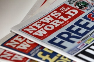 Copies of Britain's News of the World newspaper.