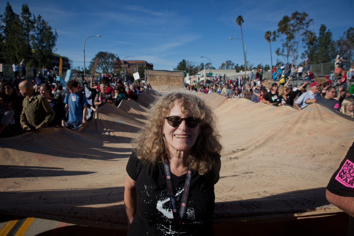 Susie Tanner of Pasadena leads an oversized constitution at in the Occupy Rose Parade protest.