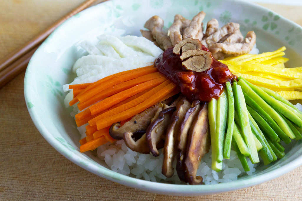 The popular korean dish bibimbap is a mix of vegetables, rice, beef, egg and red pepper paste.