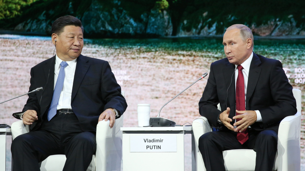The U.S. is sanctioning China's military for buying equipment from Russia that included fighter jets and surface-to-air missiles. Russian President Vladimir Putin (right) is show with Chinese President Xi Jinping, in Russia earlier this month.