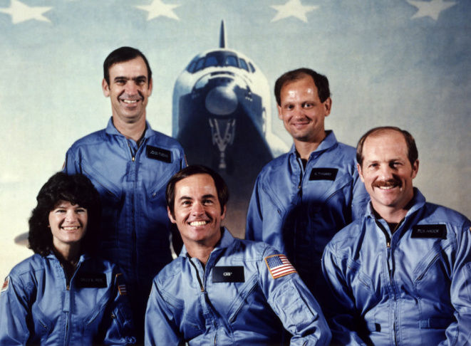 NASA astronaut Robert Crippen (C, first row), the