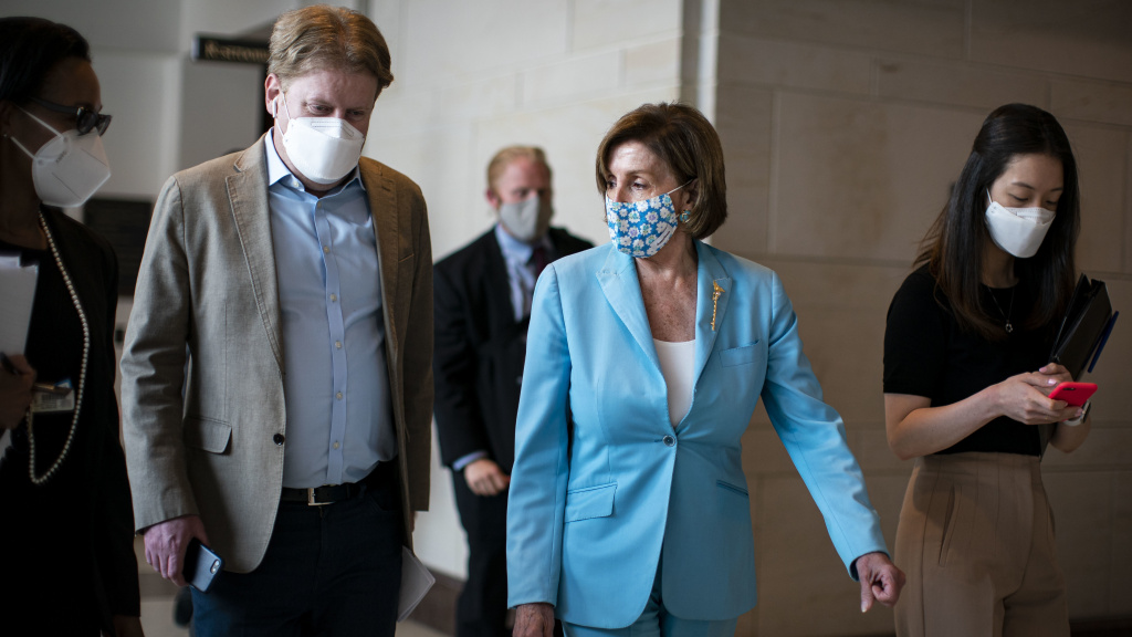 House Speaker Nancy Pelosi, D-Calif., wears a mask as she departs a news conference at the U.S. Capitol on Wednesday.