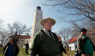Park Ranger Dan Meharg leads a group of visitors at the Sandy Hook Lighthouse in Gateway National recreation Area Saturday, April 9, 2011. A last-minute budget deal forged with tough bargaining averted an embarrassing U.S. government shutdown, cut billions in spending and provided the first major test of the divided government that voters ushered in five months ago. Dan Meharg said that Friday he wasn't sure that he would be working Saturday.