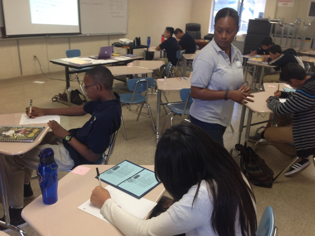 Principal Carla McCullough teaches the College Readiness class in her charter school's one-week 9th grade summer bridge program.
