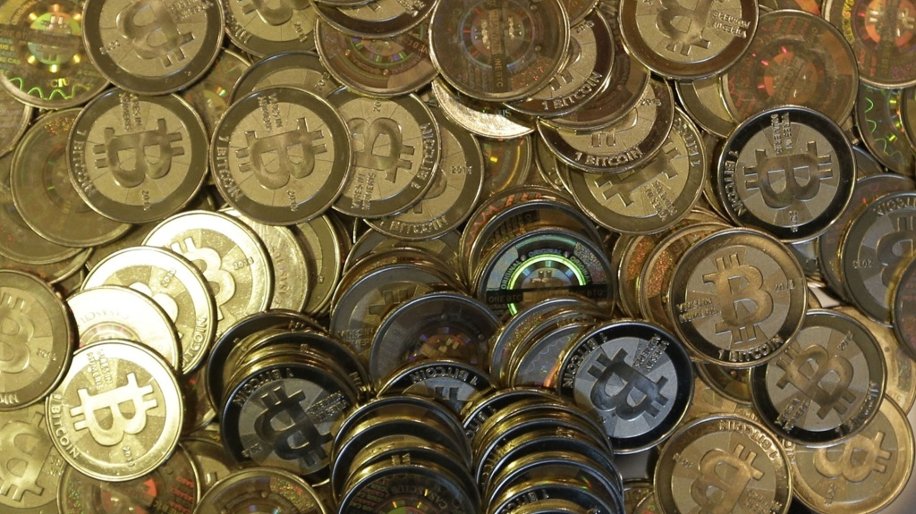A photo of tokens representing bitcoins.