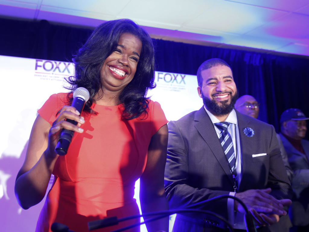 Then challenger Kim Foxx smiles at the crowd with her husband Kelley, as they celebrate her primary win as Cook County State's Attorney in 2016.