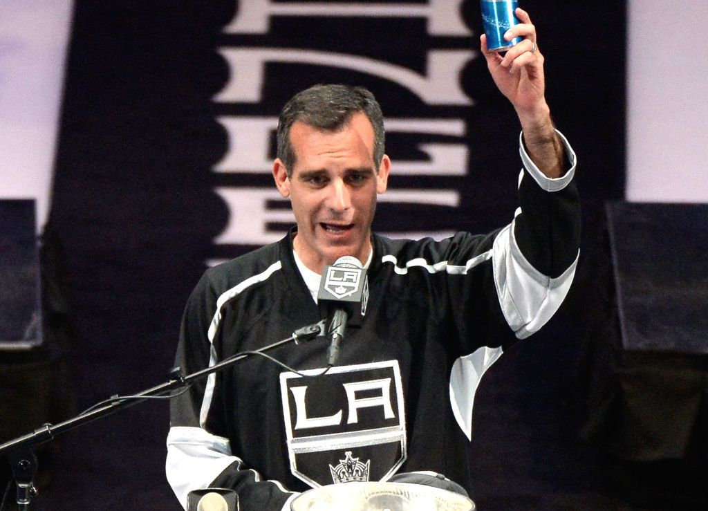 Los Angeles Kings Mayor Eric Garcetti raises a beer and swears during the Los Angeles Kings Victory Parade And Rally on June 16, 2014 in Los Angeles, California.