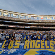 "Fans of the St. Louis Rams hold a ""Los Angeles Rams"" sign against the San Diego Chargers during their NFL Game in San Diego, California."