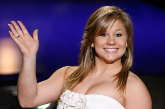 Gymnast Shawn Johnson waves as she is introduced as a judge before a preliminary competition for the 2010 Miss America Pageant at the Planet Hollywood Resort & Casino January 27, 2010 in Las Vegas, Nevada.