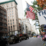 "A woman holds up a sign that says ""Thank You"" during the Veteran's Day Parade on November 11, 2013 in New York City."