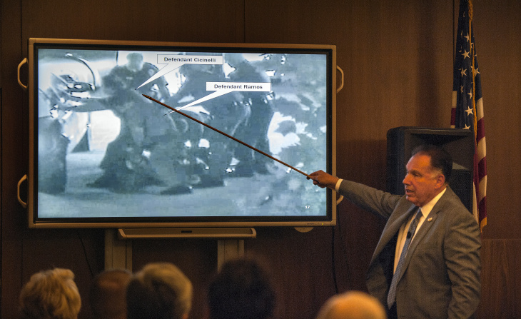 Orange County District Attorney Tony Rackauckas shows the jury an image of Fullerton police trying to subdue Kelly Thomas at the Fullerton Transportation Center on July 5, 2011 during the trial of former Fullerton officers Manuel Ramos and Jay Cicinelli on Monday, Dec. 2, 2013 in Santa Ana, Calif.  Rackauckas told jurors that Ramos and Cicinelli were responsible for the death of 37-year-old Kelly Thomas in July 2011. Thomas, whose family says was schizophrenic, died five days after the violent confrontation with six officers who responded to a call about a man jiggling car door handles in a transit center parking lot. Ramos is charged with second-degree murder and involuntary manslaughter. Cicinelli is charged with to involuntary manslaughter and use of excessive force. Defense attorneys are seeking to introduce evidence that Thomas had a history of violence and suffered from psychotic episodes due to prolonged methamphetamine abuse.