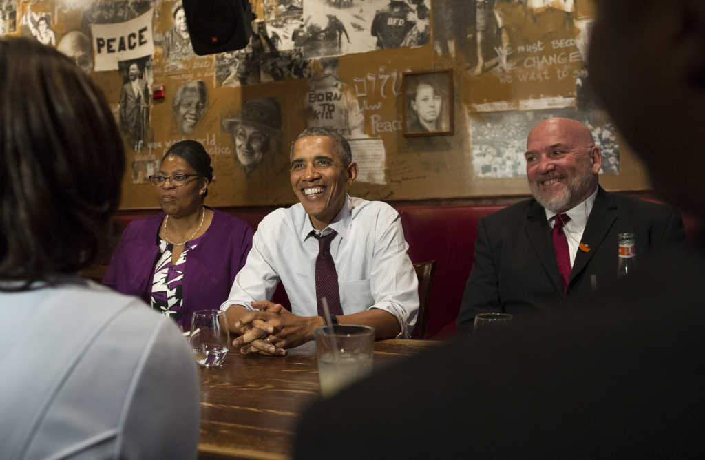 File: President Barack Obama speaks to the media after having lunch with formerly incarcerated individuals who have received commutations, including Ramona Brant (L) and Phillip Emmert (R), at Bus Boys and Poets restaurant on March 30, 2016 in Washington, D.C.