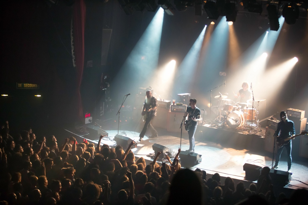 American rock group Eagles of Death Metal perform on stage on November 13, 2015 at the Bataclan concert hall in Paris, few moments before four men armed with assault rifles and shouting