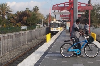 A Blue Line Train arrives at 103rd St/Kenneth Hahn Station.