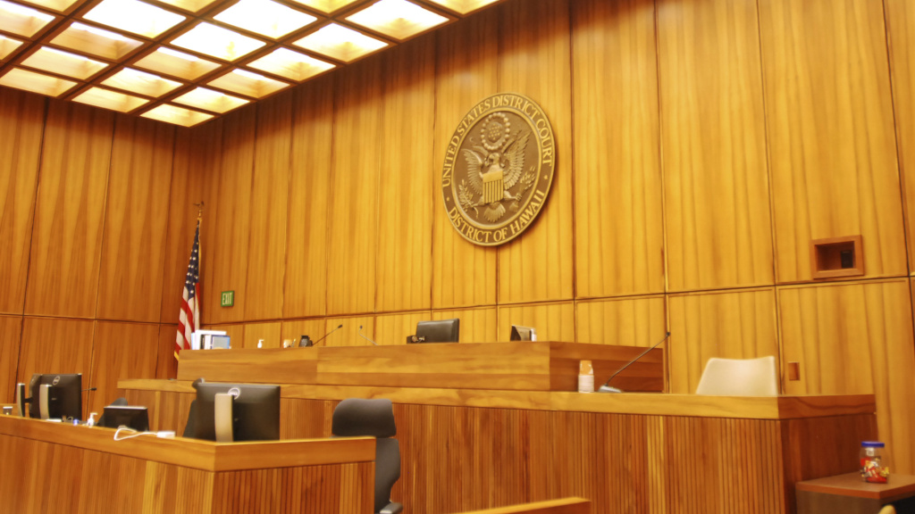 A U.S. federal courtroom sits empty in 2017 in Honolulu. A new study finds that judges with backgrounds as prosecutors or corporate lawyers are more likely to rule in favor of employers.