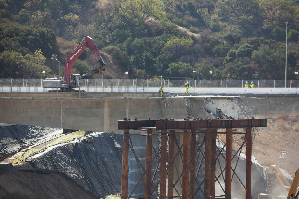 Work continued on the bridge over the top of the Sepulveda Pass. Despite the shutdown traffic flowed freely on interstates in The Valley.