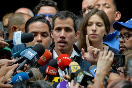 "Venezuela's National Assembly head and self-proclaimed ""acting president"" Juan Guaido speaks to the press after attending a mass in honour to the fallen in the fight for freedom, political prisoners and the exiled, at the San Jose church in Caracas on January 27, 2019"