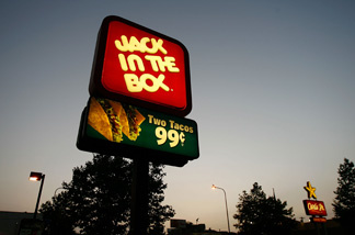 Jack In The Box and Carls Jr. fast-food restaurant signs glow July 24, 2008 on the Figueroa Street Corridor of South Los Angeles area of Los Angeles, California. The Los Angeles City Council committee unanimously approved year-long moratorium on new fast-food restaurants in a 32-square-mile area, mostly in South Los Angeles, pending approval by the full council and the signature of Mayor Antonio Villaraigosa to make it the law. South LA has the highest concentration of fast-food restaurants of the city, about 400, and only a few grocery stores. L.A. Councilwoman Jan Perry proposed the measure to try to reduce health problems associated with a diet high in fast-food, like obesity and diabetes, which plague many of the half-million people living there.