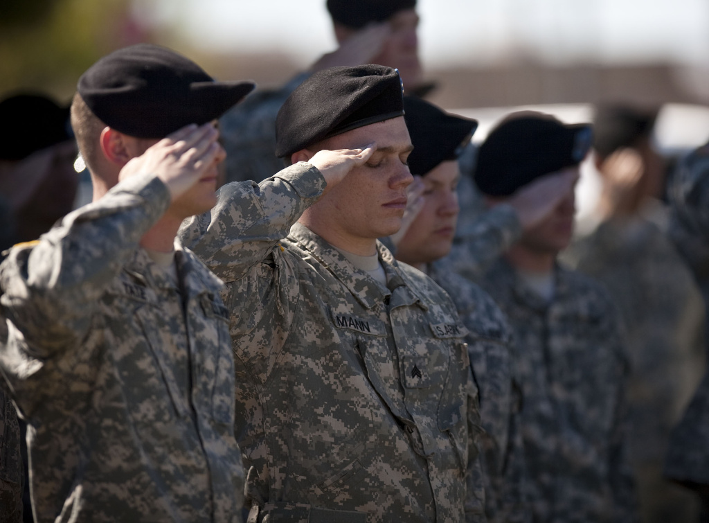 Soldiers salute at a remembrance service for the 13 victims killed in the Ft. Hood attacks in Killeen, Texas on November 5, 2010.