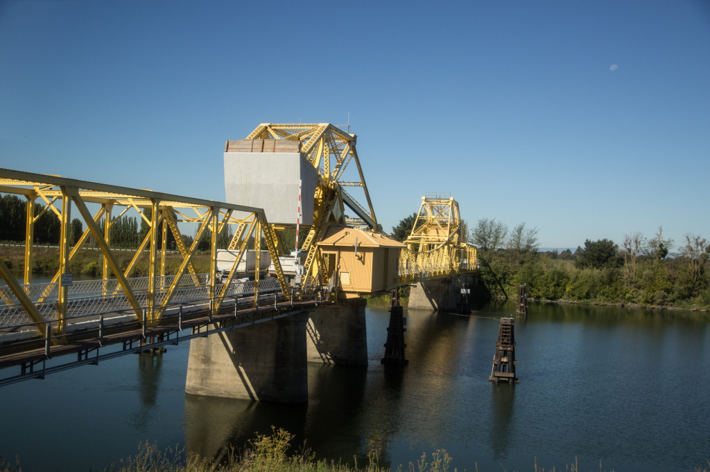 Trucks filled with agricultural products cross a bridge over the Sacramento-San Joaquin River Delta. The so-called Bay Delta Conservation Plan has two