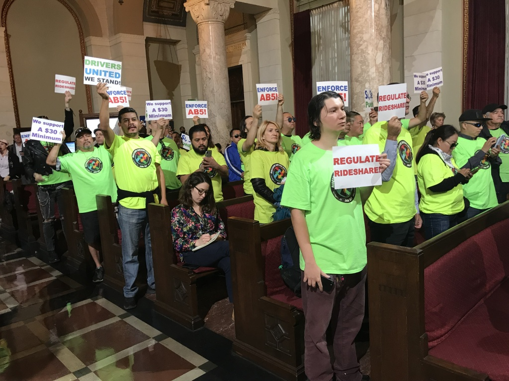 Rideshare drivers show up at Los Angeles City Hall on Tuesday, Oct. 15, 2019 to call for a higher minimum pay, Oct. 15, 2019.